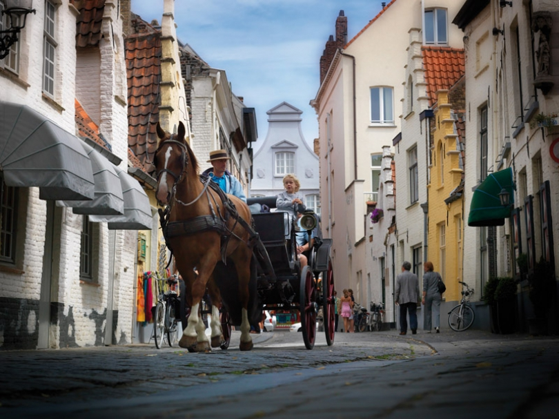 Take a walk in Bruges through an idyllic park or explore the city by horse-drawn carriage.